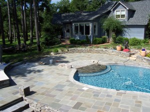 Here's a look at the pool and cut bluestone patio with surrounding stacked flagstone sitting walls.